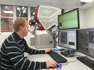 Dr. Will Rickard operating the TESCAN LYRA FIB-SEM.